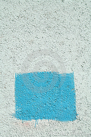Concrete wall with blue rectangle
