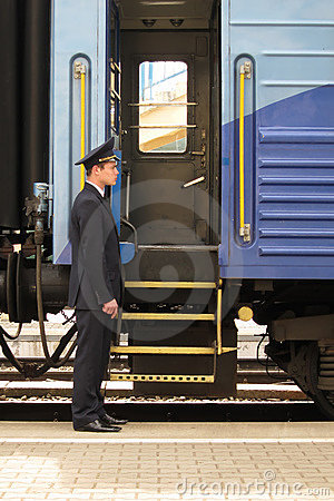 Free Conductor Beside Entry In Train Stock Image - 16062951