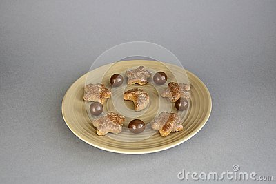 Confectionery, chocolate balls and cookies on a ceramic plate Stock Photo