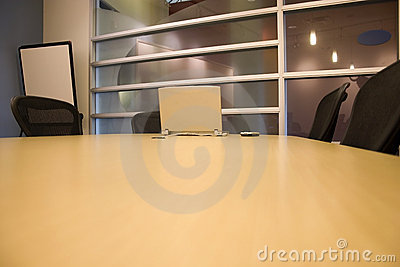 Conference Room with a Laptop and a PDA on the table