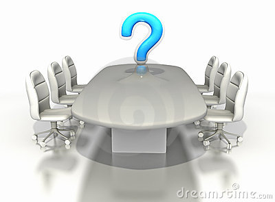 Conference room table with large question mark