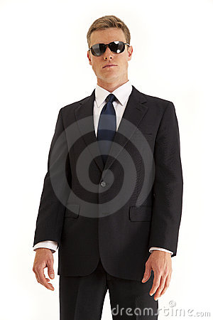 Confide young businessman with sunglasses
