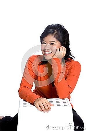 Confident Asian girl in orange top .