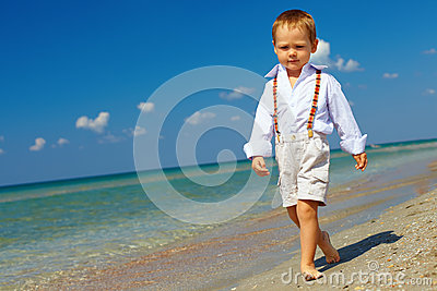 Confident baby boy goes forward firm gait