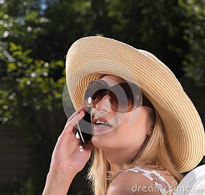 Confident blond woman on mobile phone