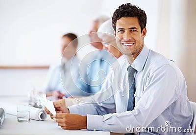 Confident business man attending a meeting