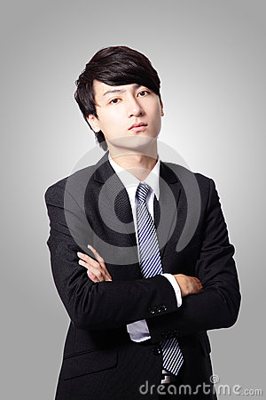 Confident business man cross his arms