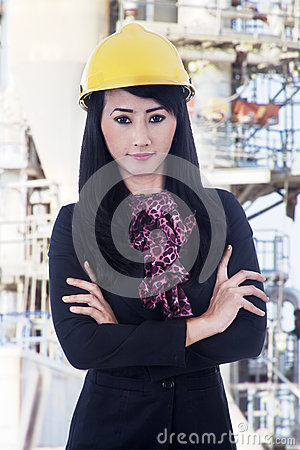 Confident business woman at construction site