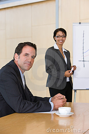 Confident business woman giving presentation