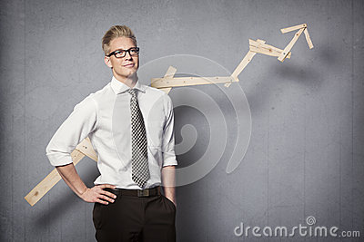 Confident businessman with graph.