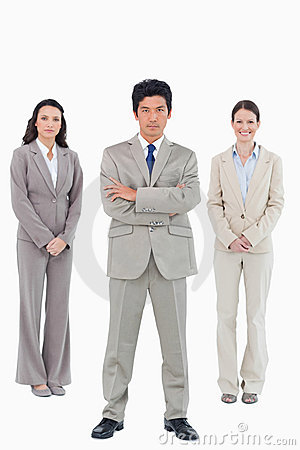 Confident businessman with his team behind him