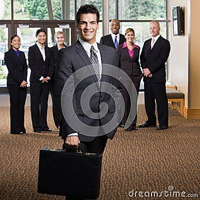 Confident businessman holding briefcase