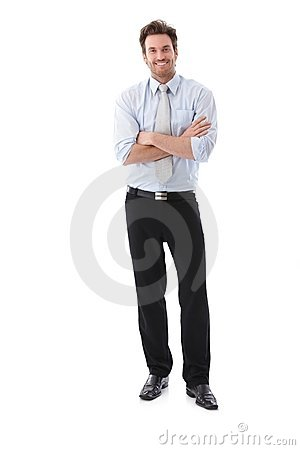 Confident businessman smiling arms crossed