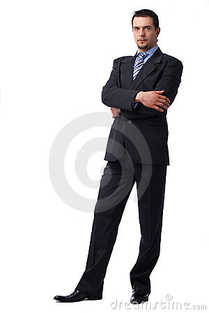 Confident Businessman Standing With Folded Hands.