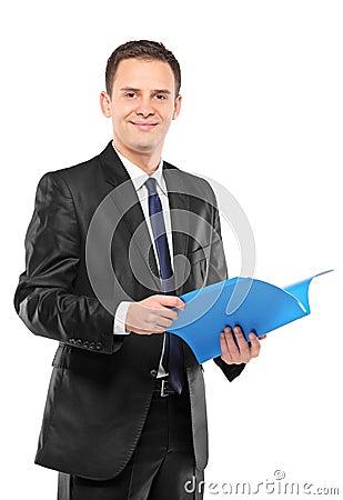Confident businessman in suit holding document