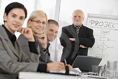 Confident businesspeople at training
