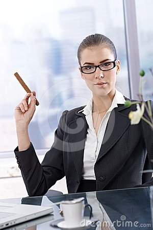 Confident businesswoman with cigar