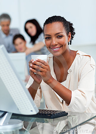 Confident businesswoman drinking a coffee