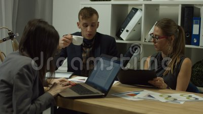 Business partners discussing charts at workplace stock footage