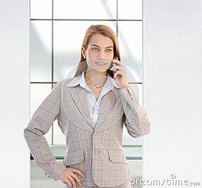 Free Confident Businesswoman On Mobile Smiling Stock Photo - 23376040