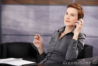 Confident businesswoman on phone call