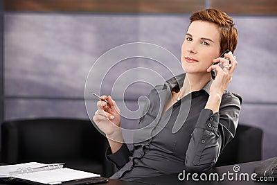 Confident businesswoman on phone call