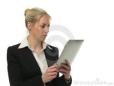 Confident businesswoman using tablet computer