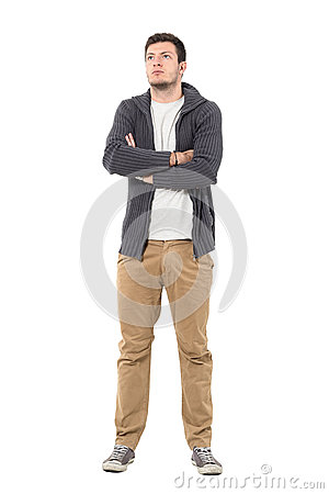 Free Confident Casual Man With Crossed Arms Looking Up Wearing Gray Zip Sweater Stock Photos - 87125013