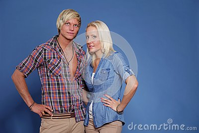Confident couple young folded arms