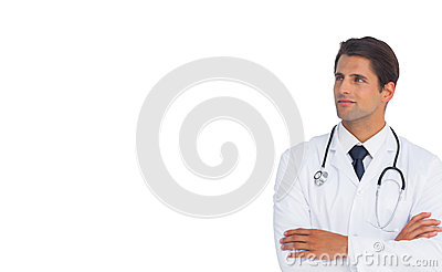 Confident doctor with arms crossed looking up