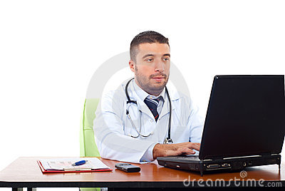 Confident doctor working on laptop