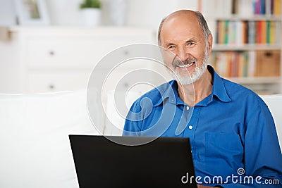 Confident elderly man using a laptop
