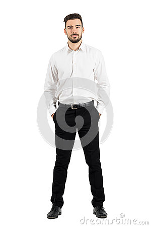 Free Confident Elegant Business Man With Hands In Pockets Looking At Camera. Royalty Free Stock Photo - 62924615