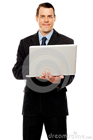 Confident executive using laptop and surfing web