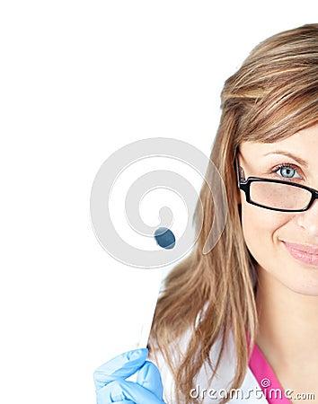 Confident female dental surgeon holding a speculum