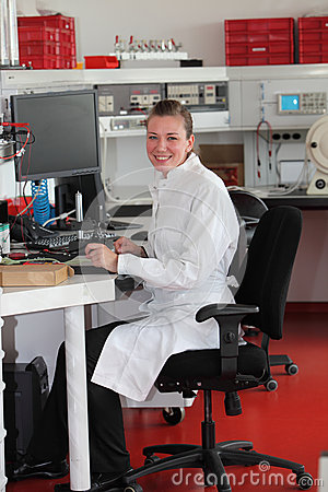 Confident female lab technician