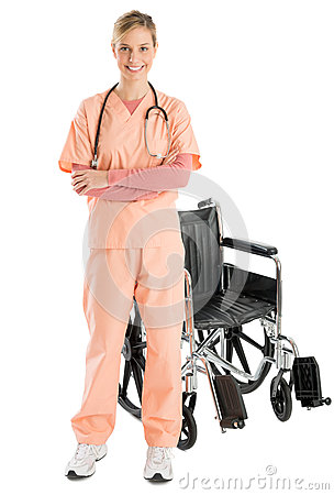 Confident Female Nurse Smiling While Standing By Wheelchair