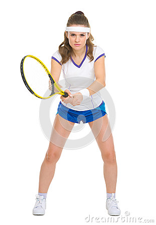 Confident female tennis player in stance