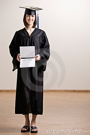 Confident Graduating Student Wearing Cap And Gown Royalty Free ...