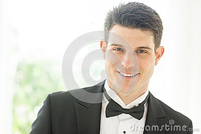 Confident Groom In Tuxedo Smiling