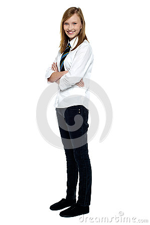 Confident high school girl posing with folded arms