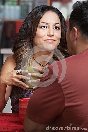 Confident Lady with Man in Cafe