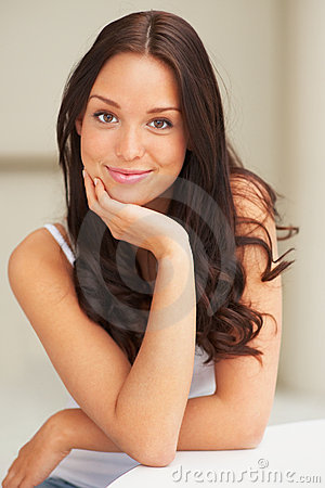 Confident looking woman posing in front of camera