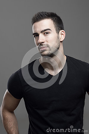 Free Confident Macho Athletic Man Wearing Black T-shirt Looking At Camera Suspiciously Stock Photography - 87777402