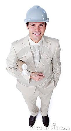 Confident male architect holding blueprints