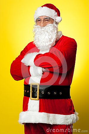 Confident male Santa posing with arms folded