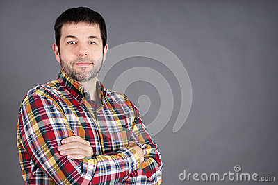 Confident man on grey
