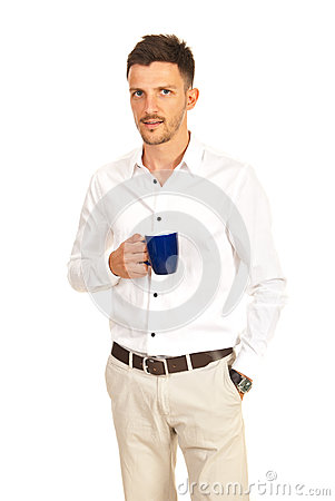 Confident man holding cup of coffee