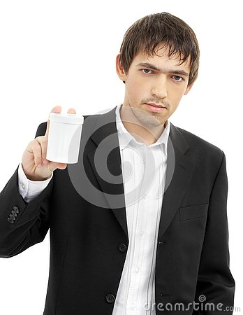 Confident man showing blank medication container