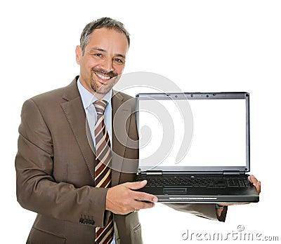 Confident marketing executive displaying a laptop